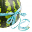 Royalty-Free Stock Photo: Watermelon wrapped around a measurement tape