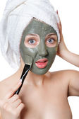 Young woman with facial mask in beauty spa. — Stock Photo
