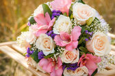 Bouquet of the bride on the chair — Stock Photo