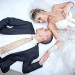 Bride and groom lying on bed — Foto de Stock   #38610421
