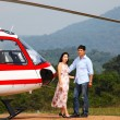Happy loving couple traveling by helicopter and smiling — Stock Photo