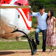 Happy loving couple traveling by helicopter and smiling — Stock Photo #37874521