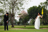 Bride and Groom Playing Golf — Stock Photo