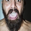 Stock Photo: Mwith beard with frightening expressions
