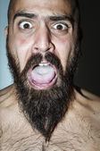 Man with beard with frightening expressions — Stock Photo