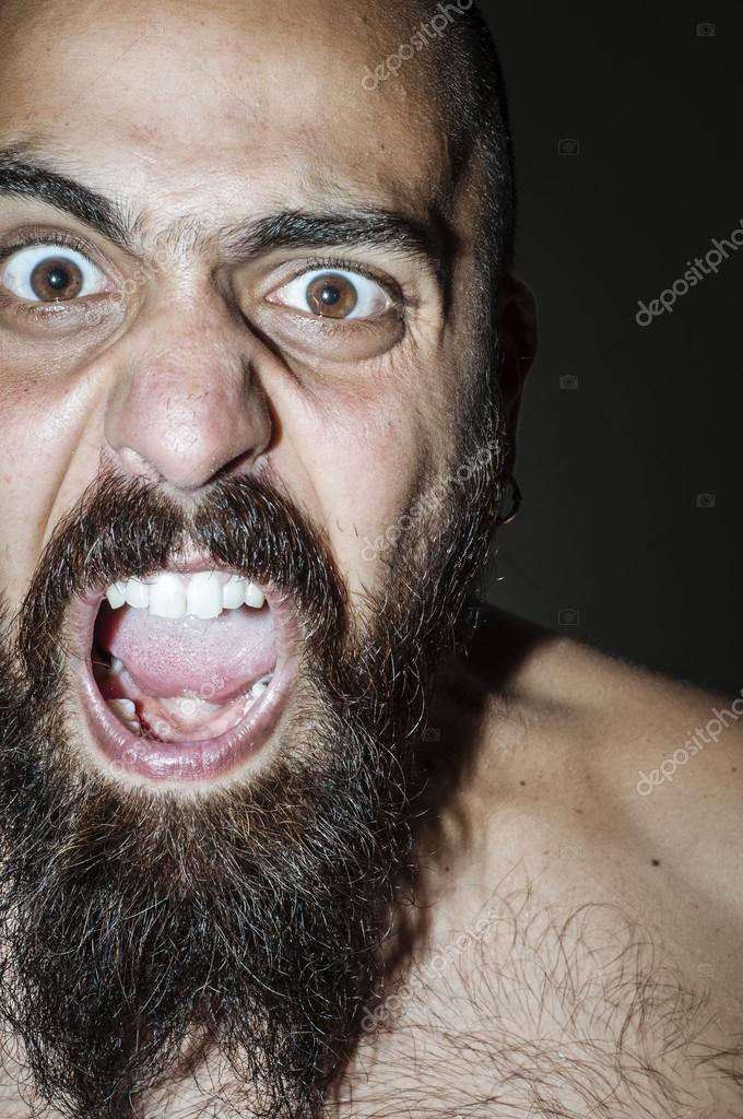 Man with beard with frightening expressions of anger — Stock Photo #12701943