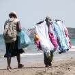 Stock Photo: Peddlers on the beach