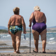 Elderly and fat old ladies walk on the beach - Stock Photo