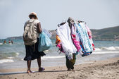 Peddlers on the beach — Stock Photo