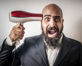 Man with a suit and beard and strange expressions — Stock Photo