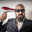 Man bearded and jacket with hairdraier and funny expressions — Stock Photo