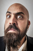 Elegant bearded man with jacket and funny expressions — Stock Photo