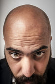Elegant bearded man showing his baldness — Stock Photo