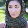 Beautiful girl with scarf safi on the lawn — Stock Photo