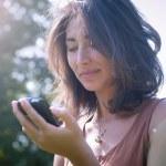 Beautiful girl talking on the phone — Stock Photo