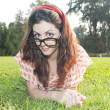 Girl with big glasses at the park — Stock Photo #13209504