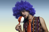 Crazy guy with blue wig — Stock Photo
