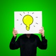 Bulb on green background — Stock Photo #13603131