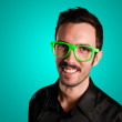 Smiling man on blue background — Stock Photo