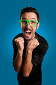 Man screaming with green eyeglasses — Stock Photo