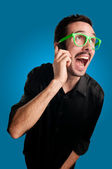 Man screaming at the telephone — Stock Photo