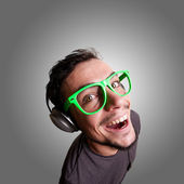 Crazy guy listening to music — Stock Photo