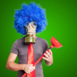 Funny guy with gas mak, blue wig and red plunger — Stock Photo #15833969