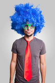 Funny guy with blue wig green eyeglasses and red tie — Stock Photo