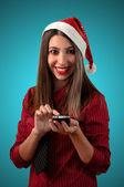 微笑着打了个电话业务圣诞女孩 — 图库照片