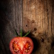 Half tomato on wood — Stock Photo