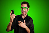 Scared man holding phone — Stock Photo