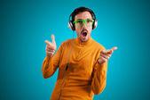 Guy with headphones listening to music — Stock Photo