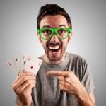 Winner guy holding poker cards — Stock Photo #19223419