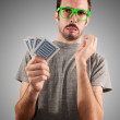 Guy holding poker cards — Stock Photo
