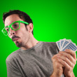 Guy spying poker cards — Stock Photo