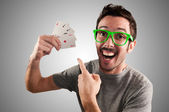 Winner guy holding poker cards — Stock Photo