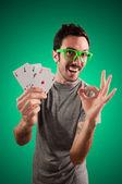 Winner guy holding poker cards — Stock Photo
