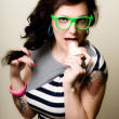 Постер, плакат: Tattoed pinup girl with heart biscuit