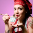 Stock Photo: Beautiful tattooed pinup cook girl