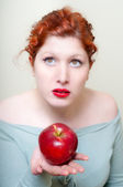 Close up portrait of girl with red hair and lips and red apple — Stock Photo
