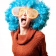 Funny girl with blue wig and big white eyeglasses — Stock Photo