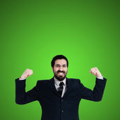 Strong business man flexing muscle — Stockfoto