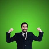 Uomo d'affari forte flessione muscolare — Foto Stock