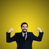 Strong business man flexing muscle — Stock Photo