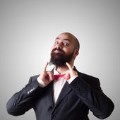 Funny bearded elegant man with papillon — Stock Photo