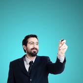 Affärsman som skriver om imaginära skärm — Stockfoto
