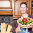 Stock Photo: Beautiful housewife with basket of vegetables