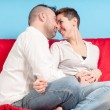 Husband and wife hugging on the couch — Stockfoto