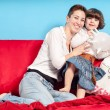 Mother and little daughter hugging on the couch — Stock Photo