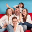 Happy family on the couch — Stock Photo